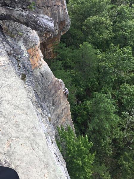 Photo of me climbing the last bit of headwall on Party Till Yer Blind.  Taken from a hiker on the endless wall trail.