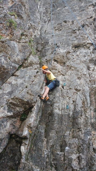 Konrad, 10 years old, on one of his first climbing outings. You can also see how closely bolted it is.  the yellow route marker is also visible at the start