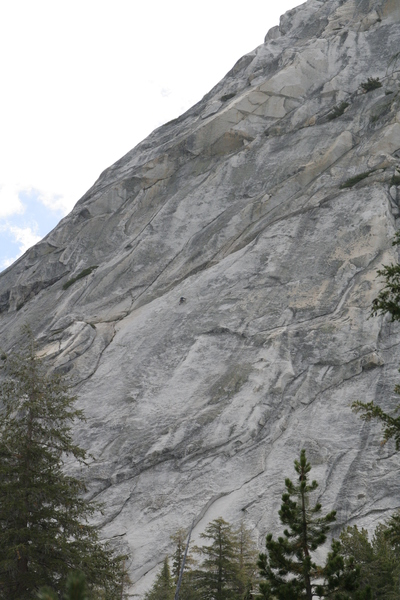 A climber approaching the top of Pitch 3.