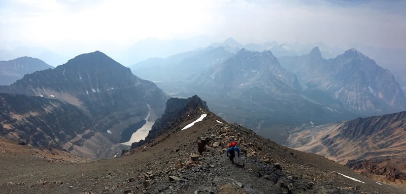 This photo was taken on the descent via the West Ridge, shortly after leaving the summit. In this photo it looks as if I am headed back up, but I am actually turning right, as the West Ridge route goes right and maintains the ridge here. (Photo by Robert Waye.)