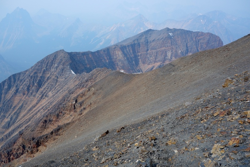 This photo was taken on the descent via the West Ridge, shortly after leaving the summit. You can see the trail. The trail then goes down (or up) the scree field.