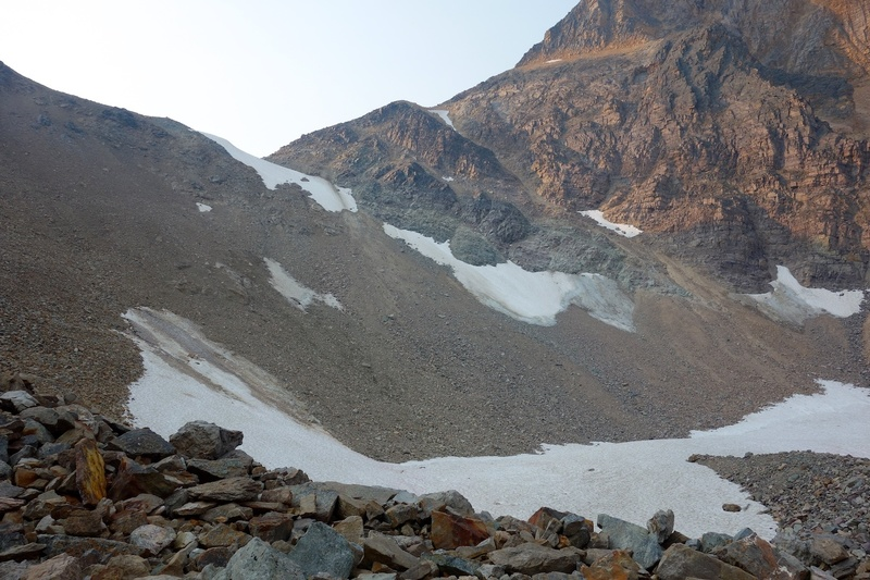 The scree and talus slopes leading to the col below the East Ridge. (Lake summer conditions.)
