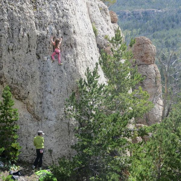 "Ella Smith on her signature route, ""Ella's Pony Ride"", 5.4, Cowboy Poetry Wall, Wild Iris, Wy"