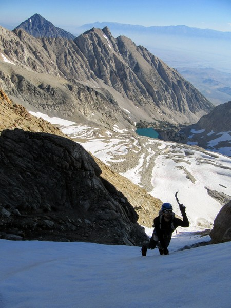 RShore climbing up the couloir, Mt Tom and Basin Mtn behind. Pic: N.Brechtel