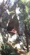 Sitting under the boulder