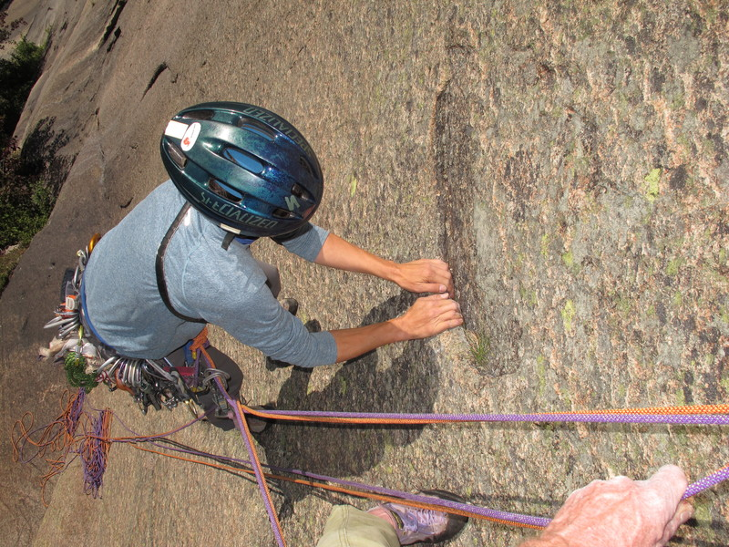 Moving up to the belay ledge on P1