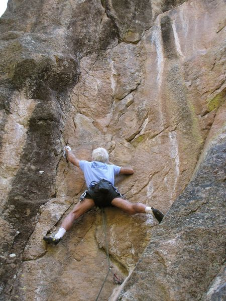 A perfect small stopper protects the entrance to the climb's crux. Cams below feet in crack on slab.