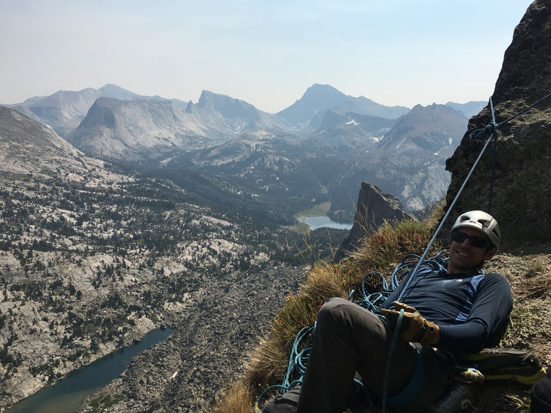 Jim enjoying the mountains on the grassy belay ledge atop pitch 8.