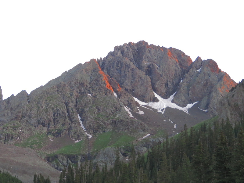 """""""Northeast Buttress?"""" (5.8), left of center, highlighted with alpenglow."""