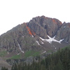 """Northeast Buttress?"" (5.8), left of center, highlighted with alpenglow."