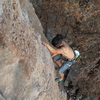 Alex working the pocket/jug fest on the arete.