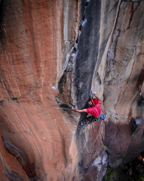 David Bloom executes the first 5.13 crux.