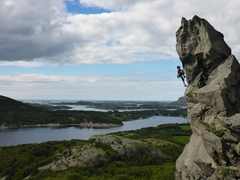 Josh climbing the Hans pillar. Photo credit Grant Francis