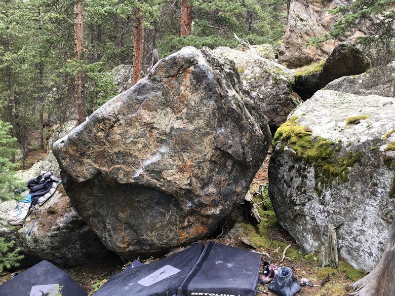 Blue Jeans and High Heels on the Lip Reader Boulder at Guanella Pass.