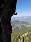 """Here is a silhouette of me on """"Magic Dagger"""" This is a great climb with an even better setting!"""