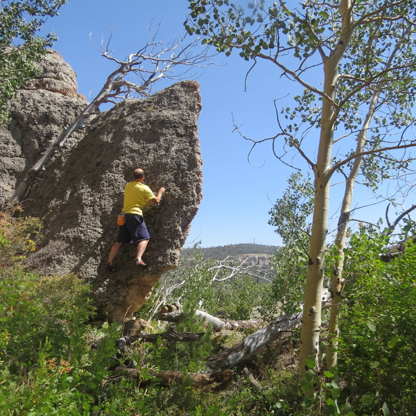 Chris Smith on a fun V0 highball just to the right.   carefully scramble off left to descend.