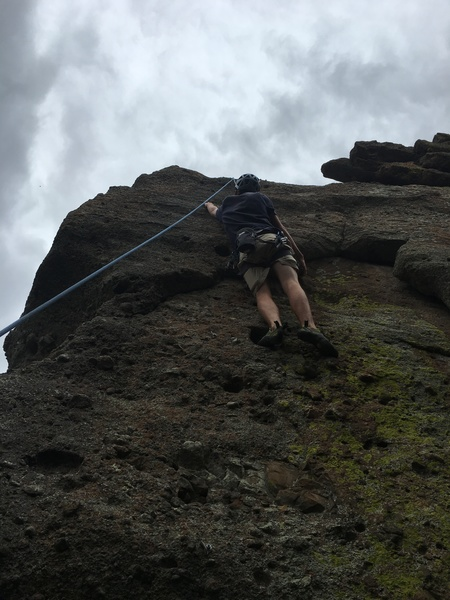 Picture from the base of the climb. Sam approaching the crux of the route.