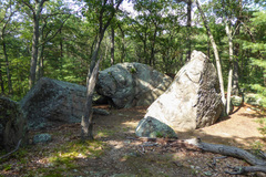 Queen's Row Boulders from the trail. Queen's Row boulder is on the right, Air Biscuit Boulder is in the center.