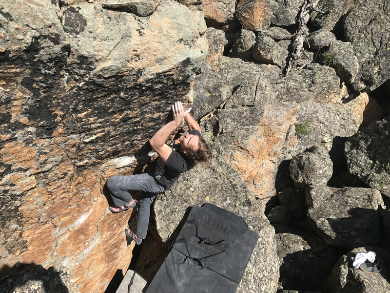 Brett on the crux of Thundercat, V4.