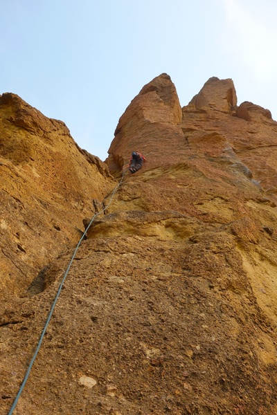 Just above the bolted belay anchor.