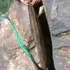 "Improved P3 anchor - Removed a huge pile of wedged tat (had to use a funkness device to get each piece out of the crack.) Replaced it with a climbing rope inside a 1"" tubular webbing sheath tied in two loops. The first loop has its own forged ring and is tied with a water knot. The tails of that loop go around again with another forged ring and end in a double fisherman's knot. The webbing should protect from UV for a long while and keep more tat from appearing."