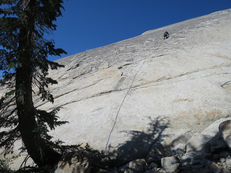 Vlada Matena clipping the first bolt on Pitch 1 (the bolt is hard to spot from the ground).
