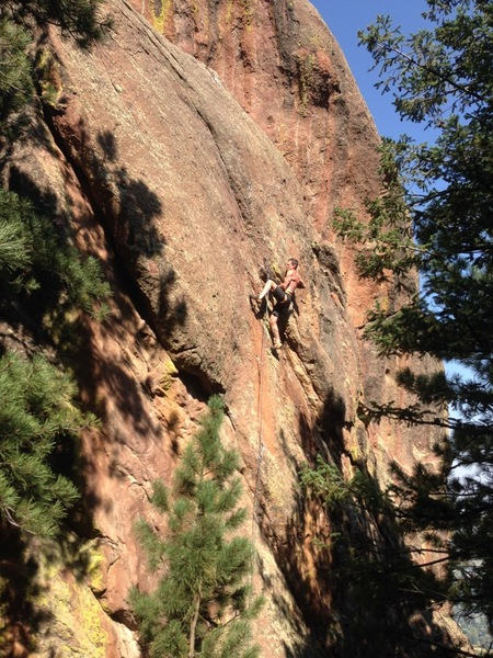 Mid-crux, moving past the 6th bolt (photo by Mark Roth).