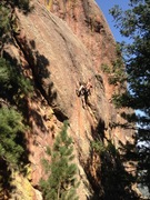 Mid-crux, moving past the 6th bolt (photo by Mark Roth)