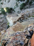 Looking down on the belay from high on the second pitch.