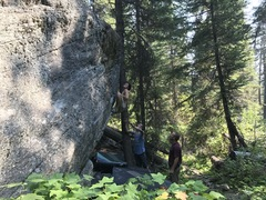 Tommy working a trail side steep arete at the swamp boulders.