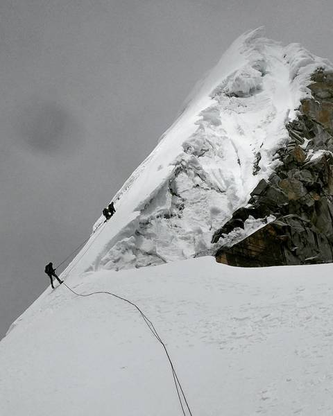 Rappelling off the face from summit ridge