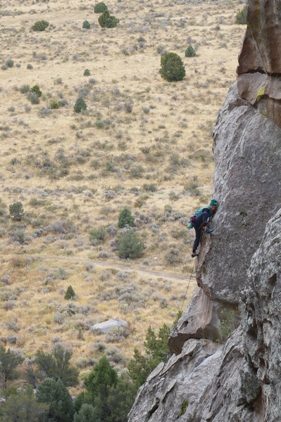 An unknown climber pulling the overhang.