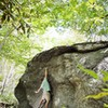 """Chris working through """"Salute"""" on the Roadside Boulder"""