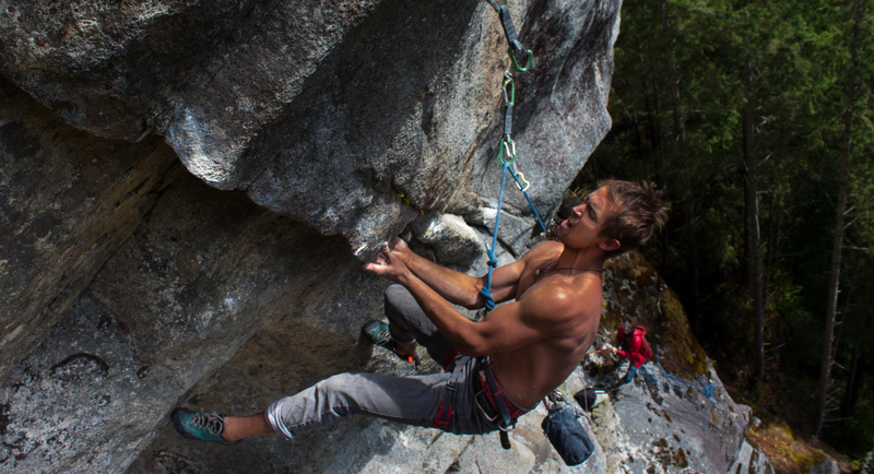 Michal biceps up on overhanging laybacking and underclinging on small feet. Pumpy.<br> <br> Photo: Ryan Hoover/Stamati Anagnostou