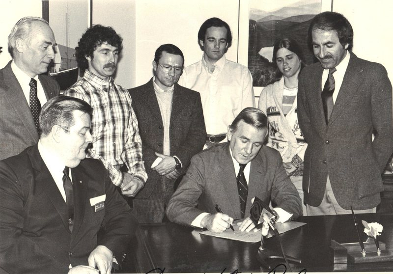 Signing the following document.Top L to R NH Politician.. Rick Wilcox.. Paul Ross.. Bill Kane..Brenda Wilcox.. NH Politician.. Bottom L to R.. NH Politician..NH Politician