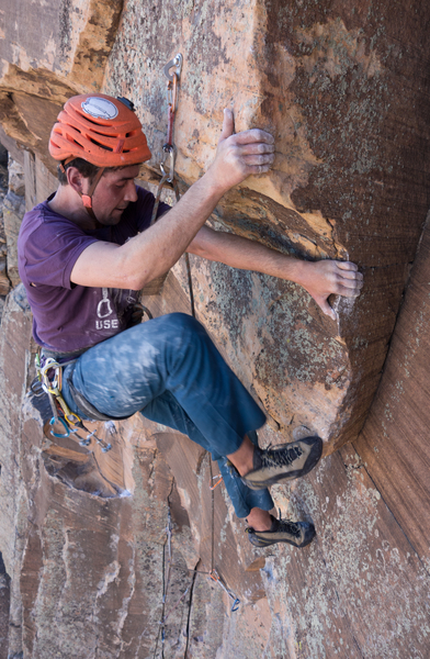 Vitaliy climbs the 10d first pitch.