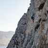 Climbing on Pescatore, with mainland Kalymnos in the background
