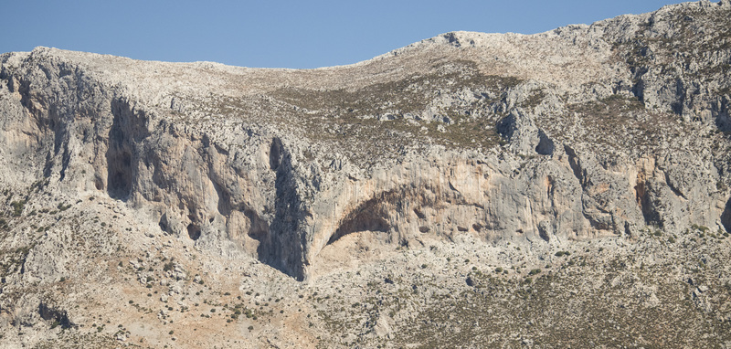 Panorama of many of the popular walls above Masouri, with the Grande Grotta the huge cave right in the middle