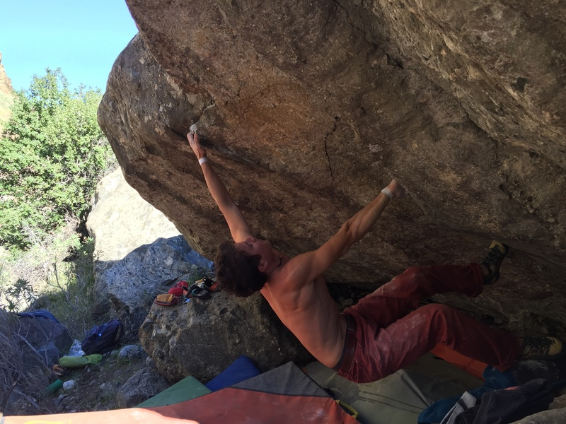 "Nick making the first big move to  the jug pocket, and debatably the crux move of ""Sub Optical"""