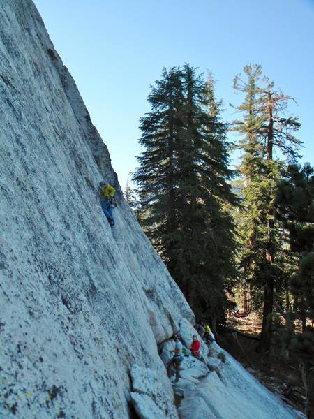 Paul leading the first pitch of west crack.  The belay ledge is more comfy than it looks from here.