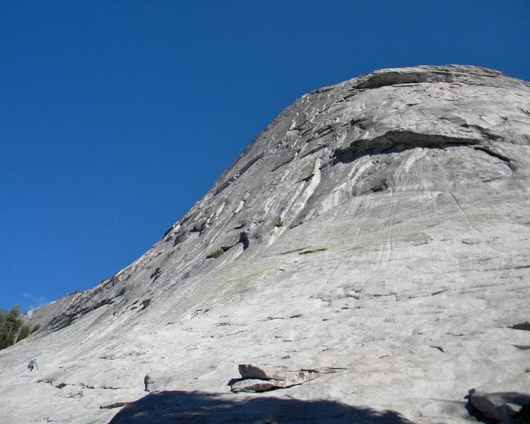 Hiking up to the empty base of regular route.  Regular route starts in the dihedral to the left of the big roof.