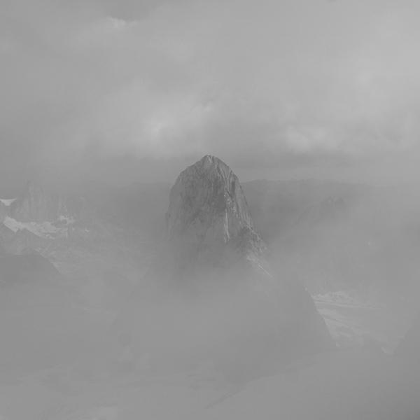 Bugaboo Spire peeking through the alpine fog.  As seen from Pigeon Spire.