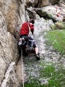 Thin corner climbing up the fourth pitch of Cinquetti