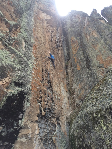 Me at the rightward traverse crux on P1 of Rasta Quechua