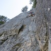 P10 (our P7). Head left shortly after you reach the small tree above to get to new rap route.