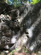 The left corner of the slab, where the climb is located.