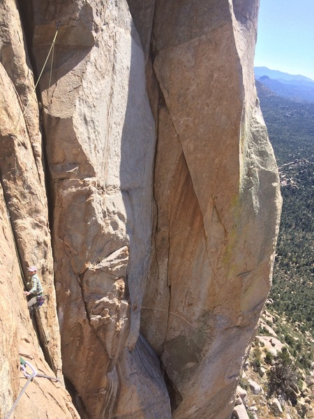 Me rope soloing back up the original route (P2). A good view into that gorgeous hand crack. Some serious traverses, though, that aren't bad lead soloing, but then heady going back down and up again. Pic by Isiah on Kingpin.