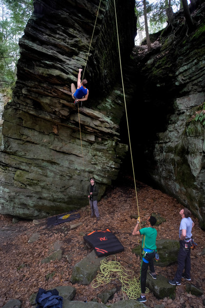 Dual belay rig on the prow. <br> Crash pad between the two belayers to cover the big rock is helpful.