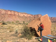 Josh moving through the crux of the problem.