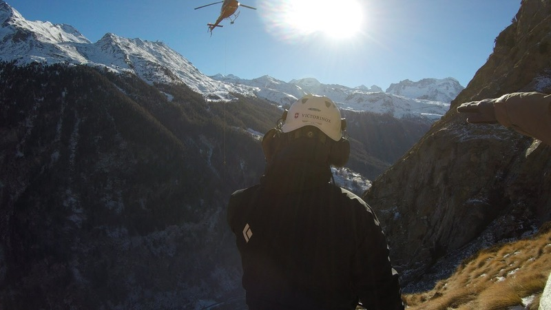 calling in helicopter during training with Air Zermatt, Switzerland